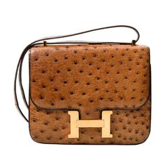 Hermes Constance Bag Ostrich 18 | From a collection of rare vintage handbags and purses at https://www.1stdibs.com/fashion/accessories/handbags-purses/