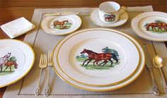Bluegrass Porcelain Tableware, on a pure white porcelain body, Julie Wear presents exquisite images of blue-blooded Thoroughbreds in scenes as lovely as her famous equestrian portraits. The graceful renderings are encircled in hand-painted burnished gold bands. Hand-decorated in the USA