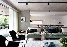 Decorar un salón moderno en tonos grises