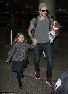 Dad on duty: David Beckham, 41, was focused on his sweet daughter Harper, 5, as he held he...