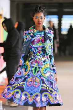 Manish Arora. I wish every ID from India or Mexico could have a dress that references traditional design like this. It reminds me of Aztec art. I'd just love to see a solo costume like this. Beautiful!