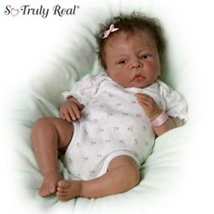 So Truly Real poseable newborn doll by Donna Lee with soft RealTouch vinyl skin, weighted for realism and a hospital bracelet you can personalize.