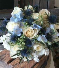 Brides bouquet. Eryngium, Delphinium, Stock, Roses and Freesia. South Wales Wedding from The Flower Pot in Pontyclun