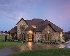 This striking brick home includes distinctive features such as a stack bond framed opening with a segmental arch and keystone, rowlock water table accent band and soldier course accent band. Jack arches with keystones make the windows pop for added curb appeal. http://insistonbrick.com/