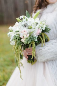 #Winter Bouquet | See more on SMP: http://www.stylemepretty.com/virginia-weddings/2013/12/18/military-homecoming-holiday-photo-shoot/  Annamarie Akins Photography