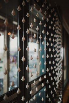 Hand folded paper diamond curtain
