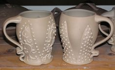 Fine Mess Pottery: Slip Trailed Mugs. Look for these to be out of the kiln in Mid-January.