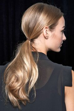 sleeked back hair in a ponytail