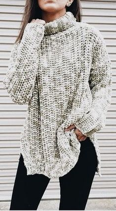 Cozy oversized gray knit sweater with black jeans.