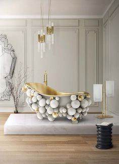 This luxury bathrooms ambience by Maison Valentina showcases the refreshing Lapiaz Bathtub and the Diamond Freestand as well as the Erosion Stool from Boca do Lobo.