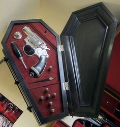 The coffin shaped ebony case is also fitted with holy water, mirror, a wooden stake and silver bullets in the shape of miniature vampire bat heads. Ouija, Vampires, Zombies, Paranormal, Unexplained Mysteries, Cabinet Of Curiosities, Love Gun, Gun Cases, Vampire Hunter