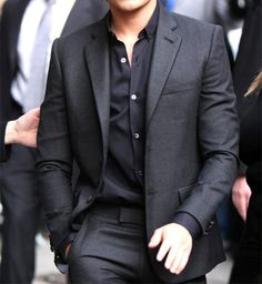 clean cut stylish look: dark grey suit & black shirt