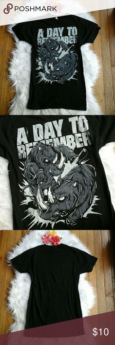 A Day To Remember Band Tee Awesome A Day To Remember band tee! Has a super cool rhino graphic on the front. In awesome condition, worn and washed just a few times. Unisex size small :)   Measurements: Total Length- 26 inches  Bust- 15 inches flat across Hot Topic Tops Tees - Short Sleeve