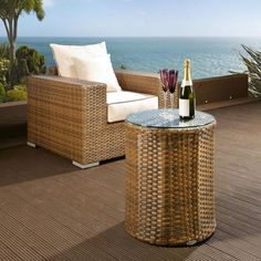 Luxury outdoor garden round side/end/coffee table brown rattan/glass. Truly stunning in design, this coffee table has a super high-class feel and is part of our mix and match sofa range. Made from fully weatherproof PE rattan, hand woven over a rust resistant frame. Call 02476 642139 or email sales@quatropi.com or visit www.quatropi.com for additional information.