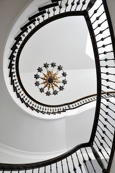 THIS BLACK AND WHITE GRANDE STAIRWAYS CURVES.......FRAME THE FIVE TIER ITALIAN BLACK CRYSTAL CHANDELIER....
