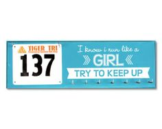 run like a girl medal hanger and a place to show your latest bib
