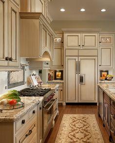 cream cabinets with light countertops & a dark center island