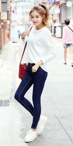 White blouse, blue jeans and a red bag - minus those shoes. I prefer converse.