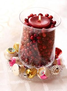 For quick holiday color, surround a cranberry-color candle inside a glass cylinder with fresh cranberries. Add a few sparkly ornaments around the base, and you're done!