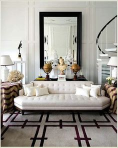 I really like this style of couch and I haven't seen anything like it. The large mirror is great too!
