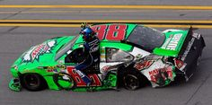 Dale Earnhardt Jr., driver of the #88,  gives teammate Jimmie Johnson, a ride on his car on the track after the big crash on the last lap at Talladega Superspeedway on October 7, 2012.