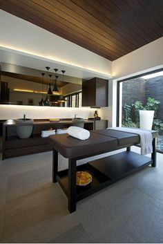 Bathroom with massage table and courtyard in PA House in Khandala, India designed by Ateliier and