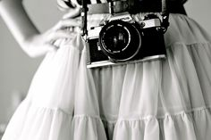 amazing picture by Riley! love the skirt and camera!