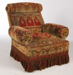 """A good pair of Napoleon III Turkish style club chairs having rolled backs and arms with fringe trimmed base circa 1880. Ht: 34"""" Width: 33"""" Depth: 33"""""""
