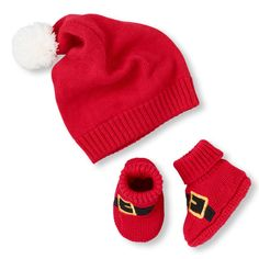 Baby's First Christmas: Keep baby toasty in this irresistibly festive two-piece Santa hat + booties! Click through to purchase. #babysfirstchristmas #giftsforbaby