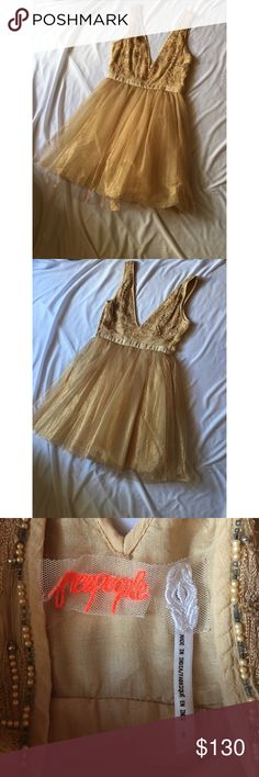 Free people Deja Vu Dress Beautiful deja cu dress from free people in the rose gold color. Size zero. NWOT. No flaws. Free People Dresses