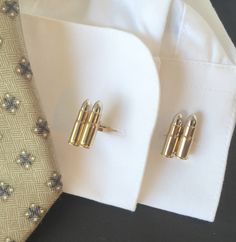 A personal favorite from my Etsy shop https://www.etsy.com/listing/274620048/silver-bullet-cuff-links-with-gold