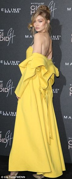 She's got a zest for life! Gigi Hadid pulled out all the stops for her Maybelline collection's launch night in London on Tuesday, leading the glamour in a showstopping lemon-yellow dress