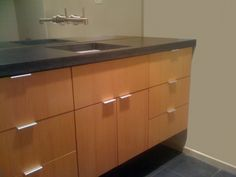 Concrete Counter With Flat Front Cabinets