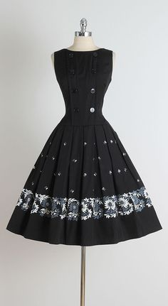 1950s Black Brushed Cotton Daisy Print Dress   From a collection of rare vintage day dresses at https://www.1stdibs.com/fashion/clothing/day-dresses/