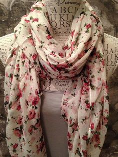 Beautiful cream flower print scarf, this is such a lovely soft and floaty scarf that can be worn all day.  It's a generous size but lightweight and very comfortable.  Covered in numerous flower posies, a great casual scarf for all seasons and ages.  Machine Washable.  Approx. size is 170cm x 95cm.