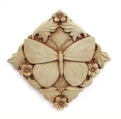 Acanthus Butterfly Plaque Hand Cast Stone (Terra Cotta) by Carruth Studio. $38.00. This butterfly surrounded by flowers evokes a sense of peace and a connection with nature. It makes a lovely gift, and is the perfect accent for any garden, deck or sunroom. It is slightly larger than most plaques, and can be displayed hanging or resting in a flower bed or lawn.