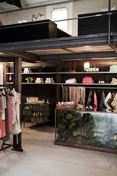 The Collector Store design by BRICKS Amsterdam.  Black metal and wood mixed with life sized terrarium in this contemporary retail design.