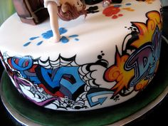 This Graffiti Birthday Cake was baked by Icing by Design. She has used gel colors to hand paint the graffiti.