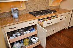 Kitchen cabinet with slide out shelves by Neal's Design Remodel.