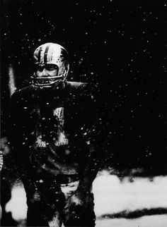Photographer/Creator  J. Bruce Baumann  Collection  1970  Publisher  Grand Rapids Press  Caption/Description  Football player stands on the field during a game played in the snow.