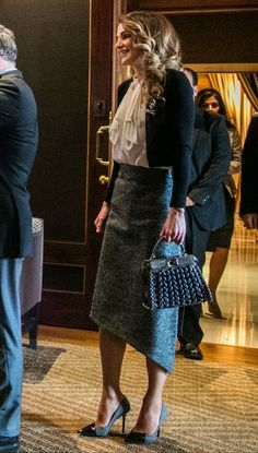 8 February 2017 - King Abdullah and Queen Rania meet some families of armed forces' martyrs - skirt by Balenciaga, bag by Fendi