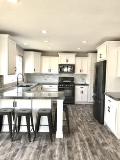 This kitchen was completely remodeled using budget-friendly materials. We elevated the look with custom concrete countertops & black slate appliances for a clean, sleek look. The luxury vinyl flooring brought a rustic design element to the project. Kitchen Room Design, Kitchen Redo, Modern Kitchen Design, Home Decor Kitchen, Interior Design Kitchen, New Kitchen, Home Kitchens, Kitchen Remodel, Kitchen Layout Plans
