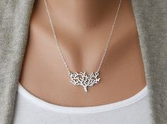 This necklace is pretty. I'm fond of the natural tree element and silver. But what really caught my eye here is the prominence and angle of this person's clavicles.