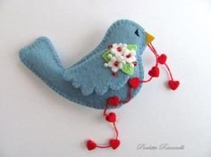 This is the sweetest little bird. Love the detail of the flowers on her wing.