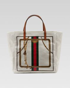 I'm thinking about treating myself to her, hmmmmm? Small Crystal Web Tote Bag by Gucci at Neiman Marcus.