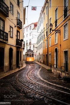 Yellow Tram Afama District Lisbon Portugal by JoeDanielPrice check out more here https://cleaningexec.com