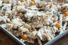 Enjoy this Halloween Chex Mix made with your favorite kinds of cereal, halloween colored m&m's and melted white chocolate! It's dangerously addictive.