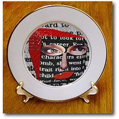A 3D Repousse with a Face on it made from many with words and red Plate