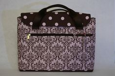 This is the front view of the bag. You can see the zipper pocket. Beside it are three pen slots. The polka dot fabric is a flap that is kept closed with velcro. The bottom of the bag is also made from the brown and pink fabric. The bag is lined with Polka Dot Fabric, Pink Fabric, Polka Dots, Laptop Bag, Laptops, Zipper, Pocket, Electronics, Brown