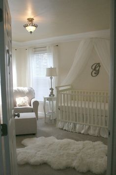 White and gold girls nursery, A mostly white with gold accents nursery - damask walls, bronze and gold details, a white fur rug, all white furniture, and art deco and art nouveau details., Looking into the nursery., Nurseries Design